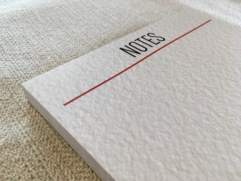 """A large notepad that says """"Notes"""" at the top."""