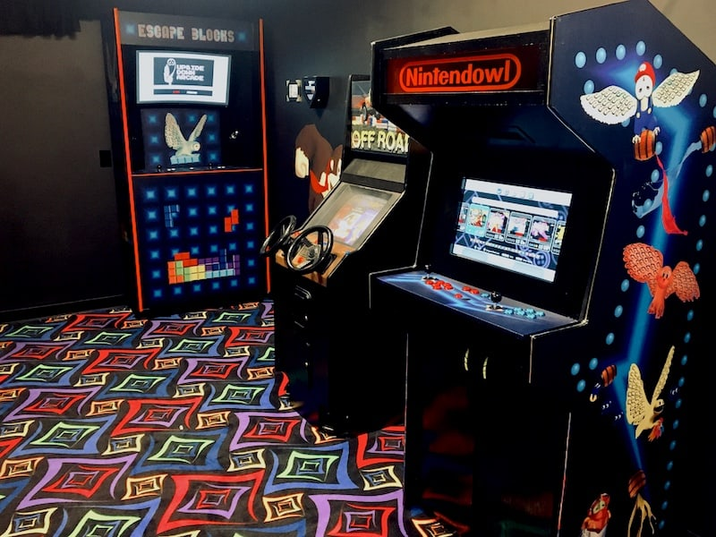 """In-game: A few arcade cabinets, the closest one reads, """"Nintendowl"""""""