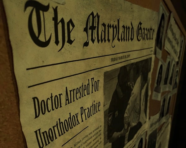 "A bulletin board with documents including a newspaper clipping with a headline reading ""Doctor Arrested For Unorthodox Practice."""