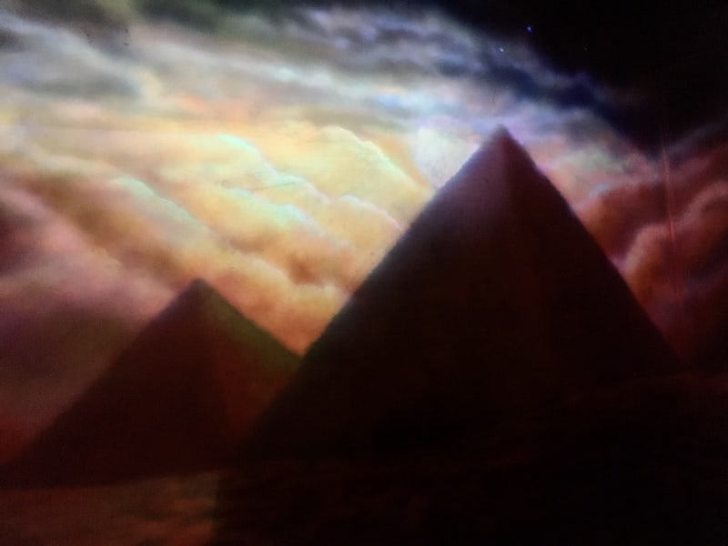 In-game: a beautiful mural of Egyptian pyramids in the moonlight.