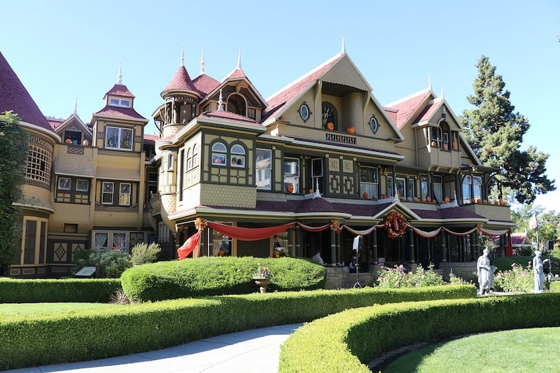 Exterior of the Winchester Mystery House mansion decorated for Halloween.