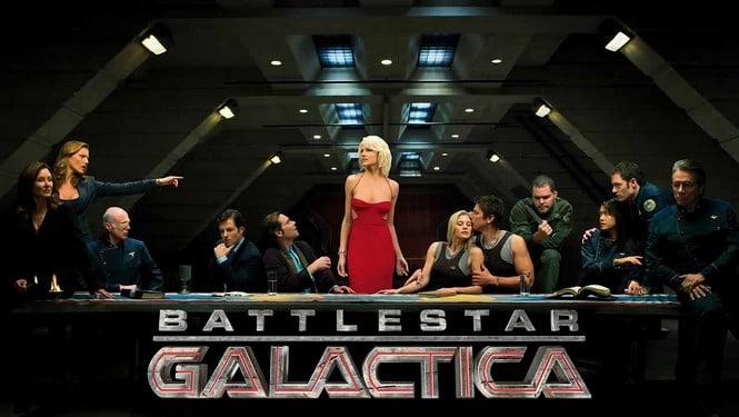 Battlestar Galactica cast sitting at a table.