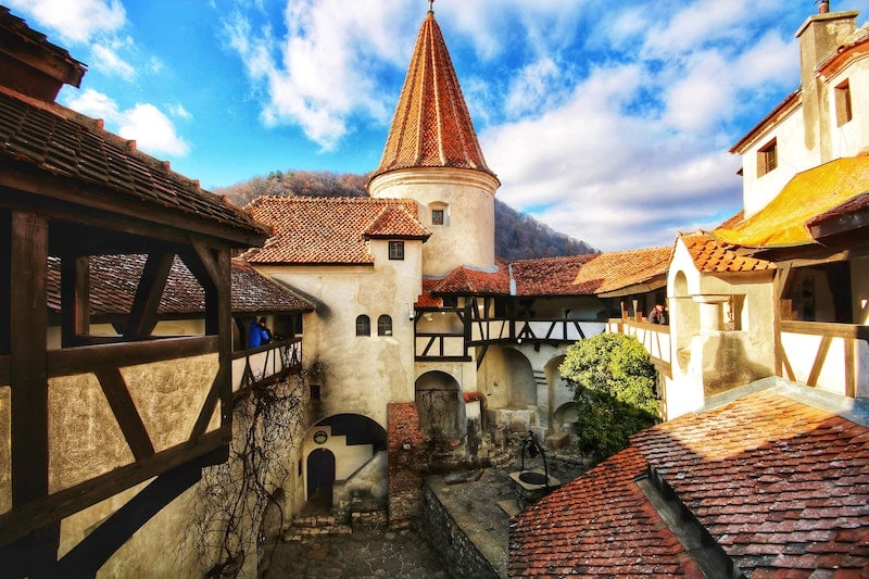 Bran Castle's iconic tower on a beautiful day.