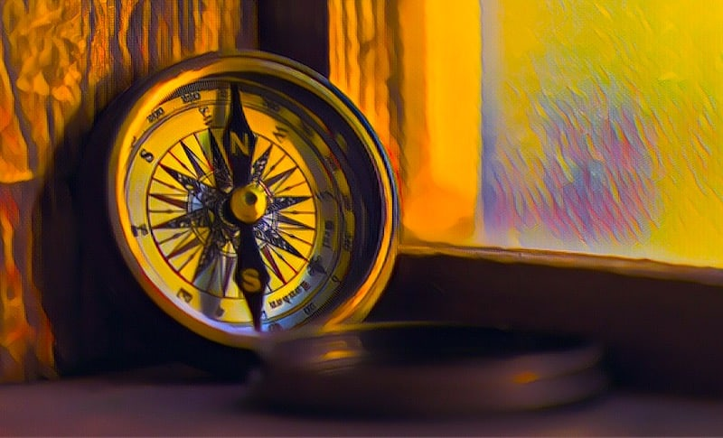 Stylized image of a compass leaning against a window sill
