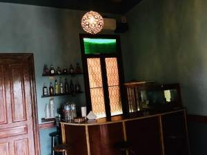 In-game: the bar in the mansion, illuminated by stained glass.