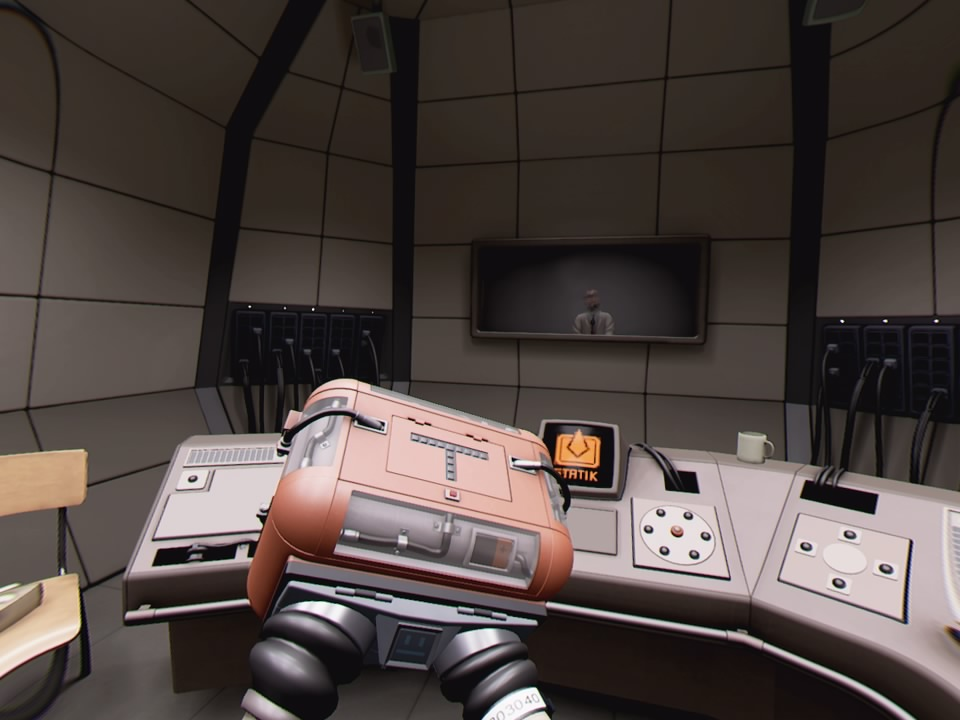 The first room of the game. The player examines the puzzle box around their hands as Dr. Ingen looks through a window.