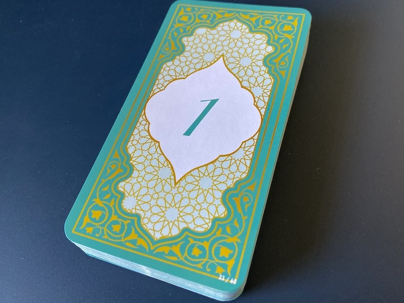 Beautiful and guilded blue, white, and gold card backs.