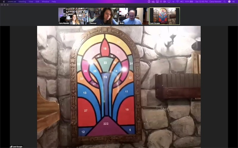 A stained glass window where each piece of glass is a different color and numbed.