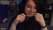 Theresa smirking while playing with a pencil.