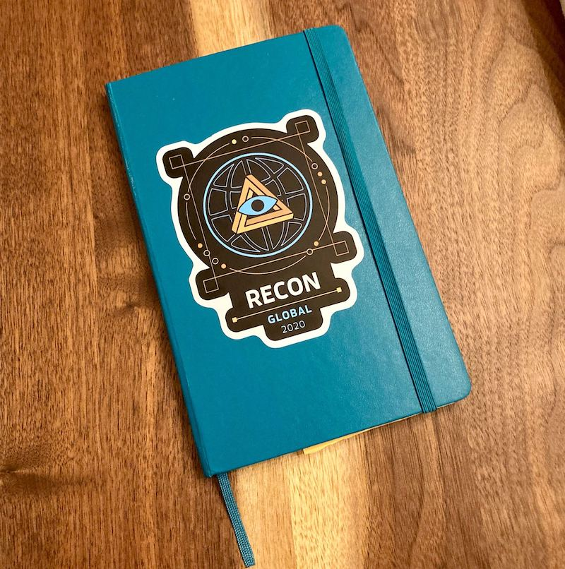 Notebook with the RECON die-cut sticker.