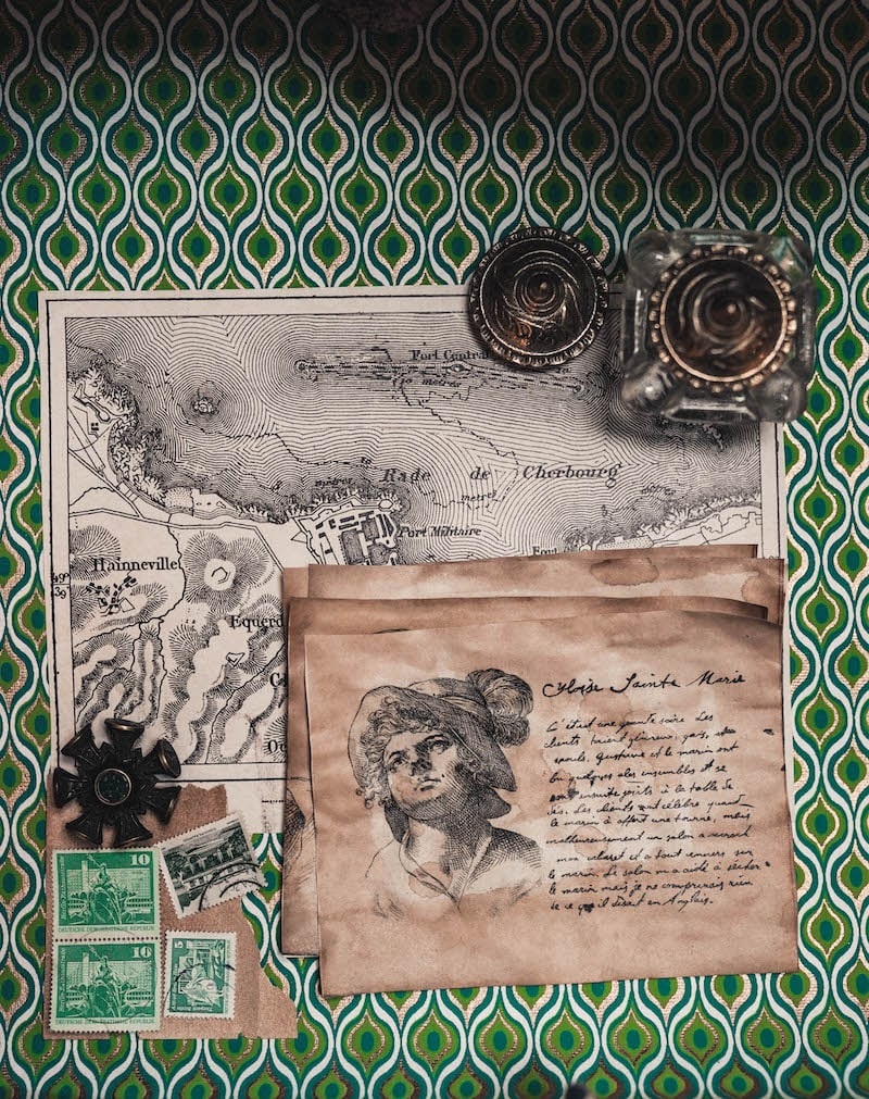 An assortment of maps, drawings, and letters.