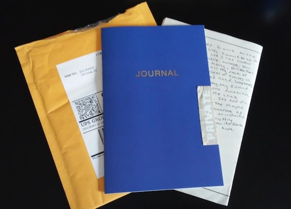 "A journal marked ""private"" with a written note and a bubble mailer underneath."