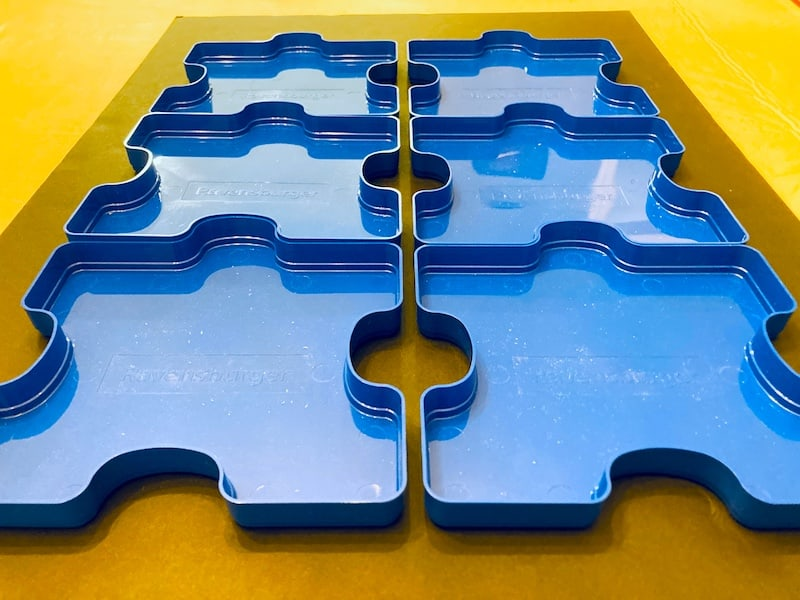 Puzzle trays only sort of interlocking.
