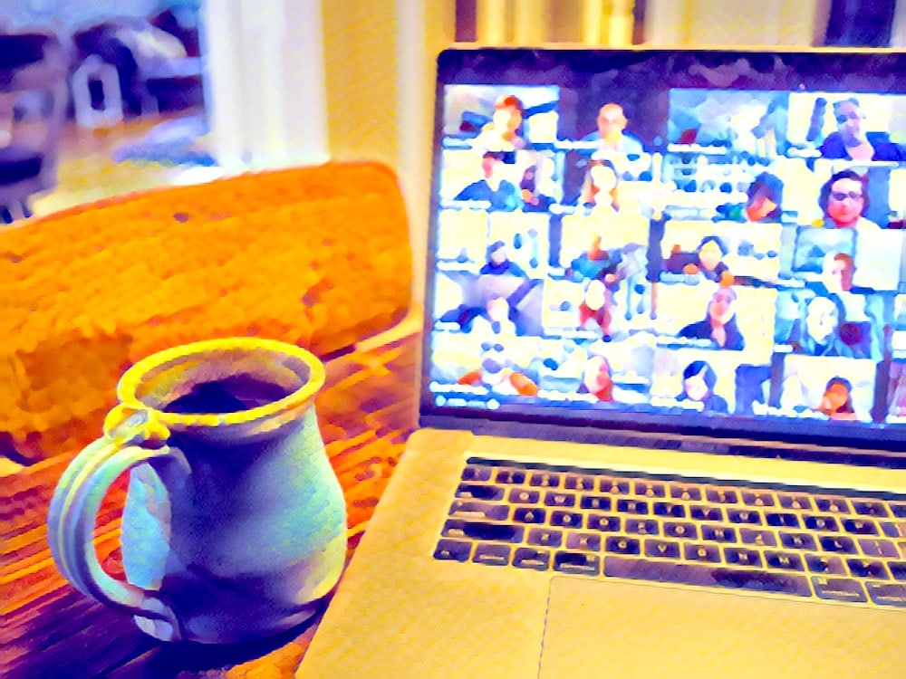 Stylized image of a laptop with a large Zoom meeting and a cup of coffee.