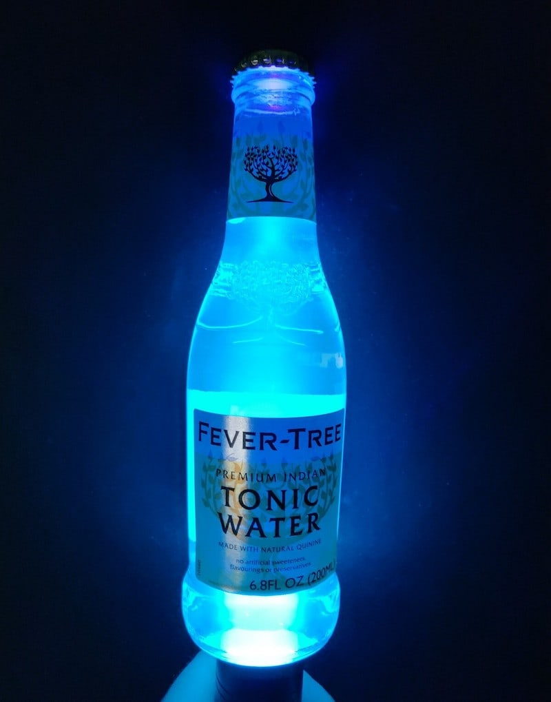 A fever tree bottle glowing under blacklight.