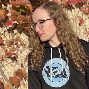 Lisa in the REA hoodie in Autumn
