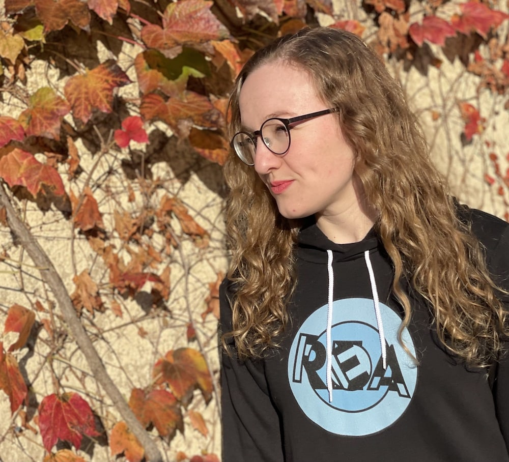 Lisa in the REA hoodie in Autumn