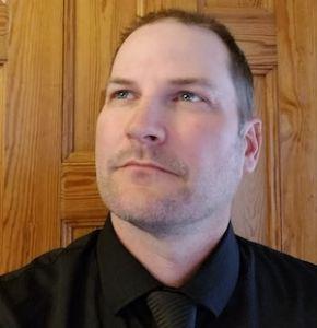 Headshot of Richard Burns looking pensive