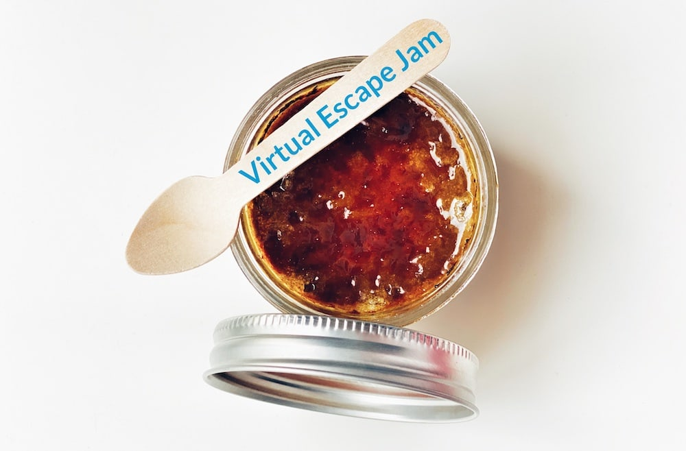 """An open jar with a wooden spoon labeled, """"Virtual Escape Jam."""