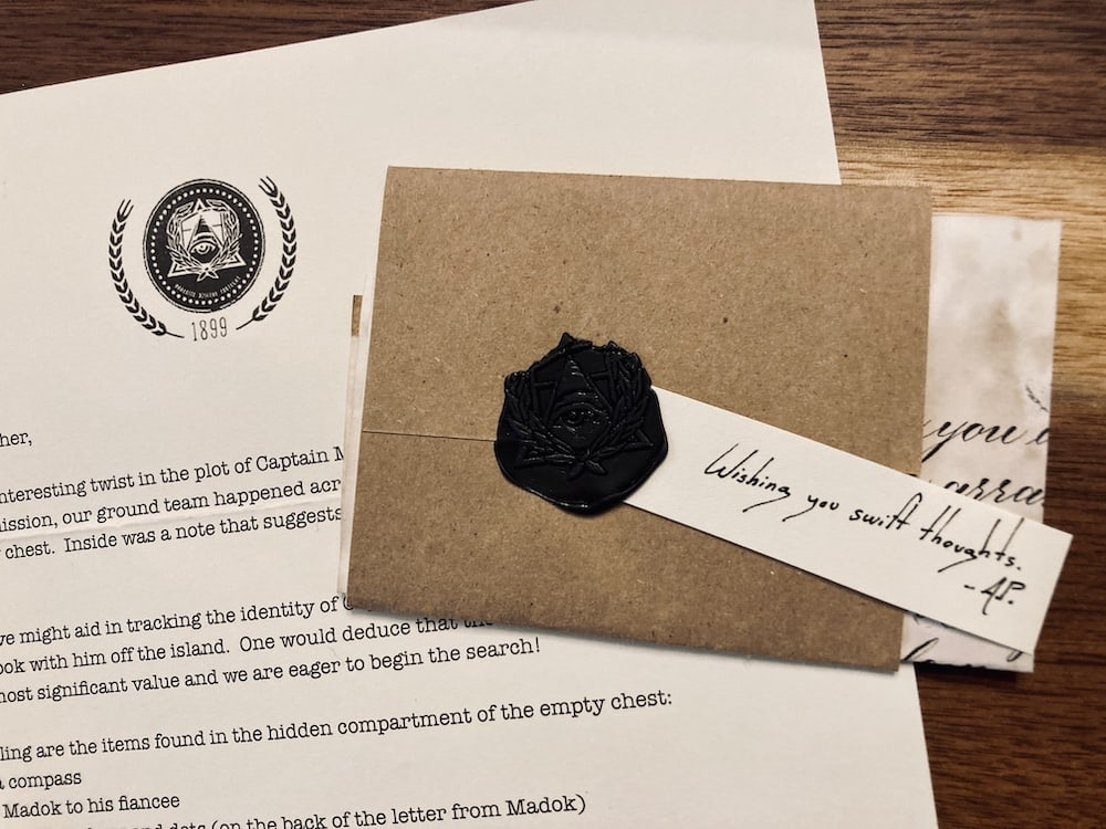 A wax sealed note with a letter containing instuctions.
