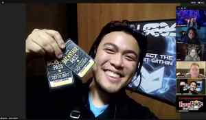 Jayson from Fuzzy Logic holding up a pair of backstage passes.