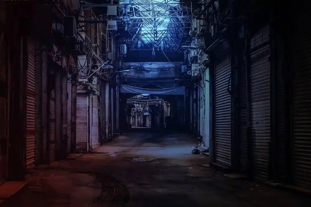 Image of an empty back alley as the sun rises.