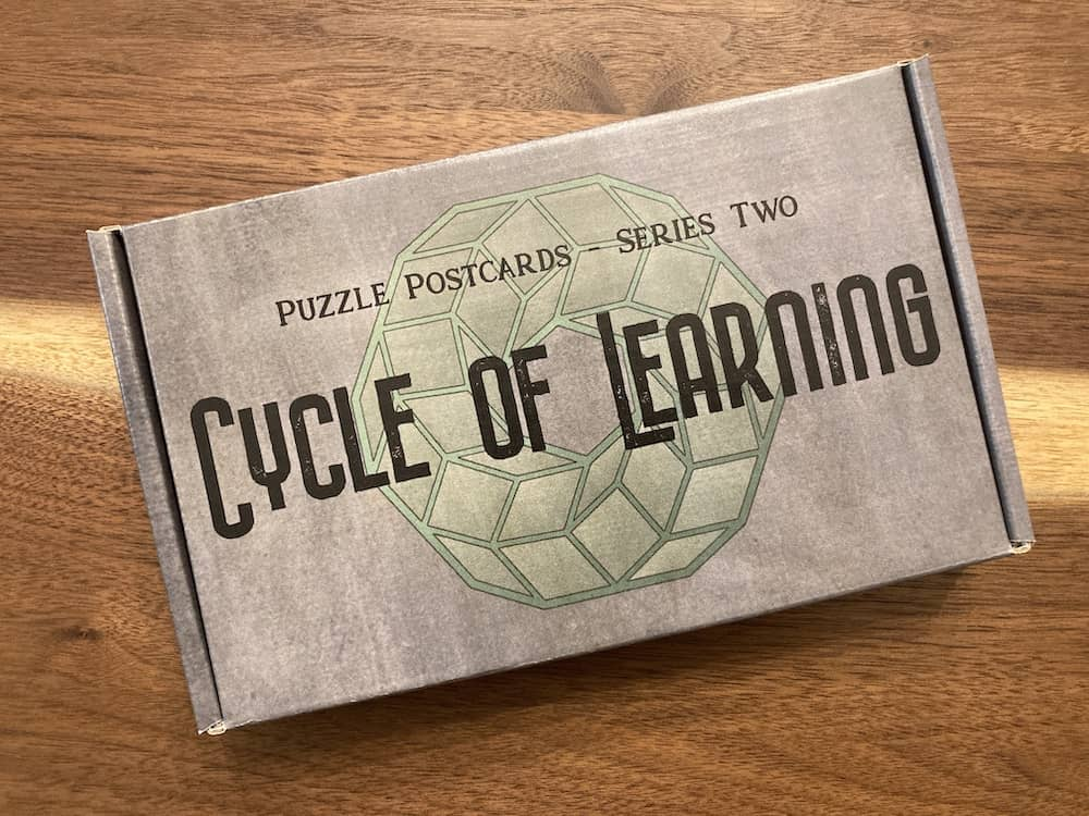 Cycle of Learning game box has a 3d mobius strip