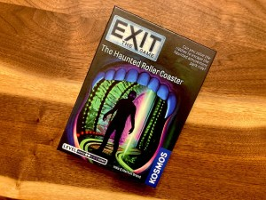 Exit The Game Haunted Roller Coaster box art depicting a specter on tracks.