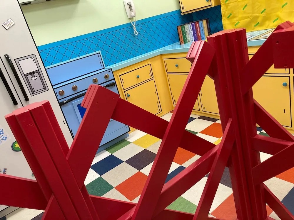 Tommy's animated kitchen viewed through a playpen.