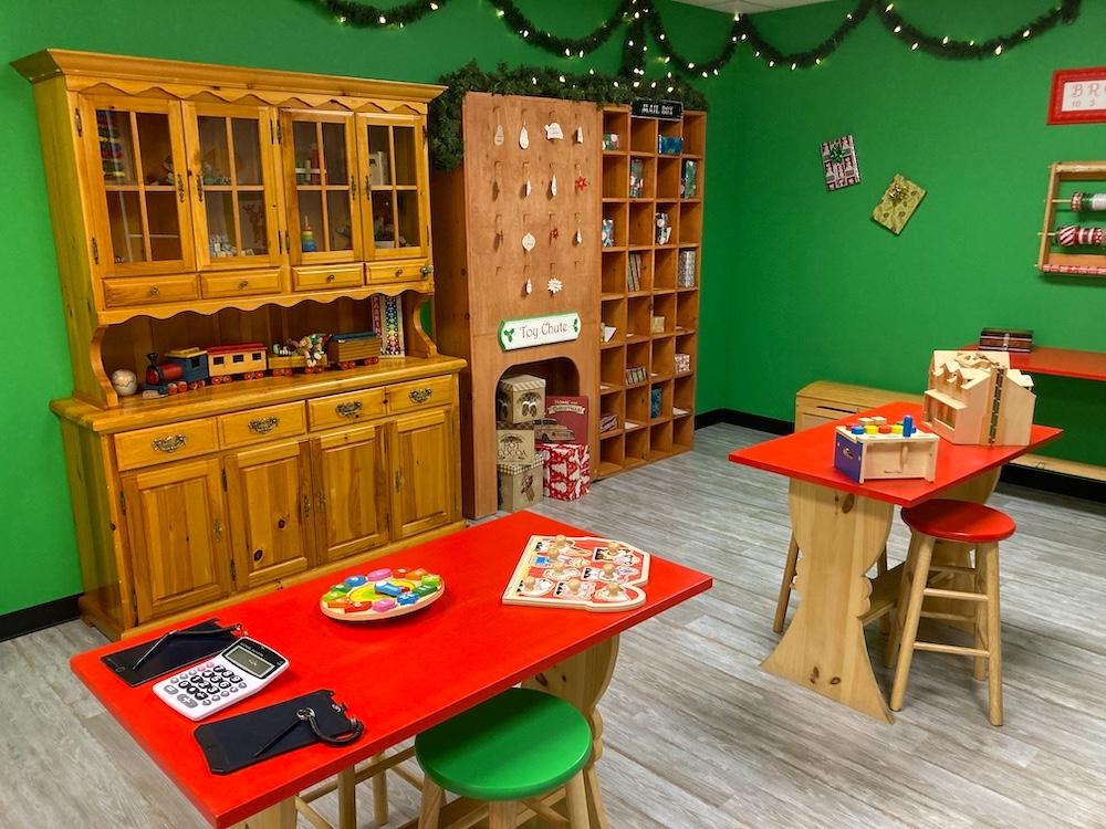Elf workshop filled with toys.