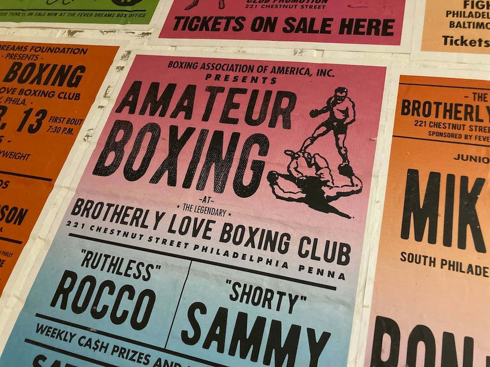 A wall of boxing fight posters.