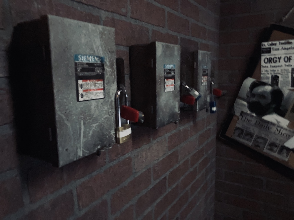 4 electrical boxes, each locked with a padlock.