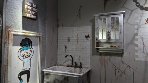 """A bloodied sink beside a sign that reads, """"How to effectively tie-up victims"""""""