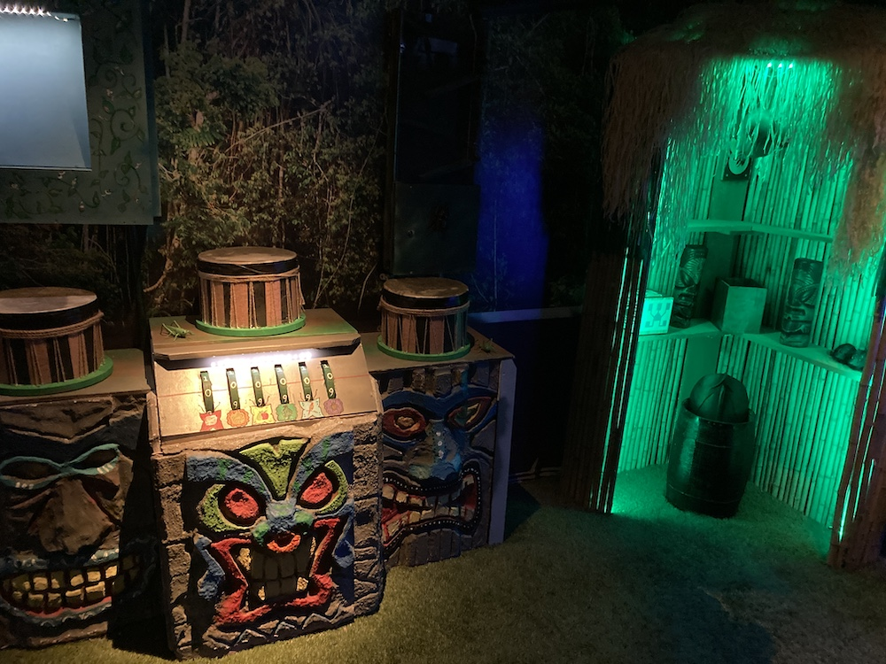 A jungle set with colorful tribal drum props and puzzles.