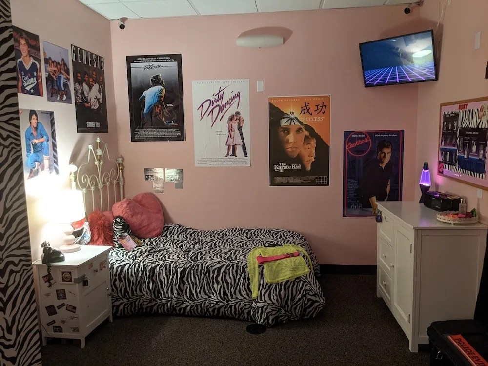 Wide view of a 1980s bedroom.