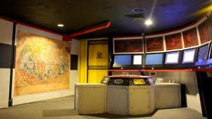An assortment of screens, controls, and maps in a submarine.