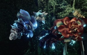 Large beautiful flowers bioluminescing with fiber optic cable.