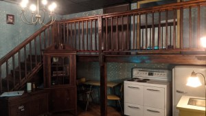 A 2 story set with an old kitchen.