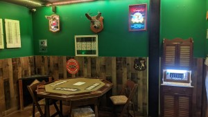 A poker table in an old dive bar.