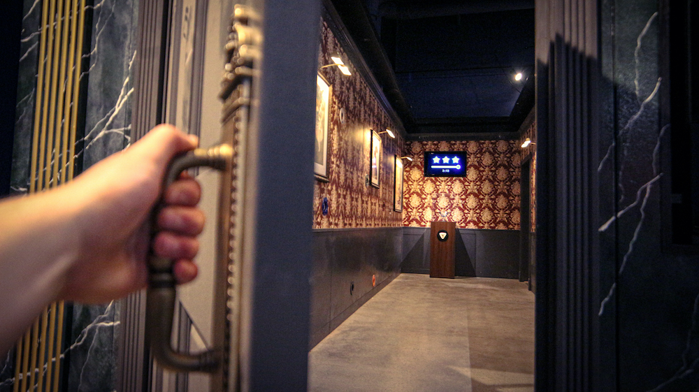 A player opening the door the Museum Heist game.
