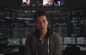 An agent named Briggs, briefing the team over Zoom.