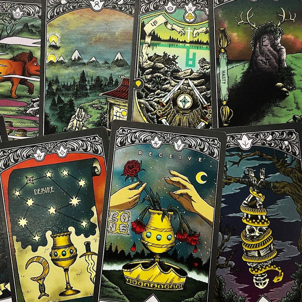 7 assorted tarot cards with stunning art.