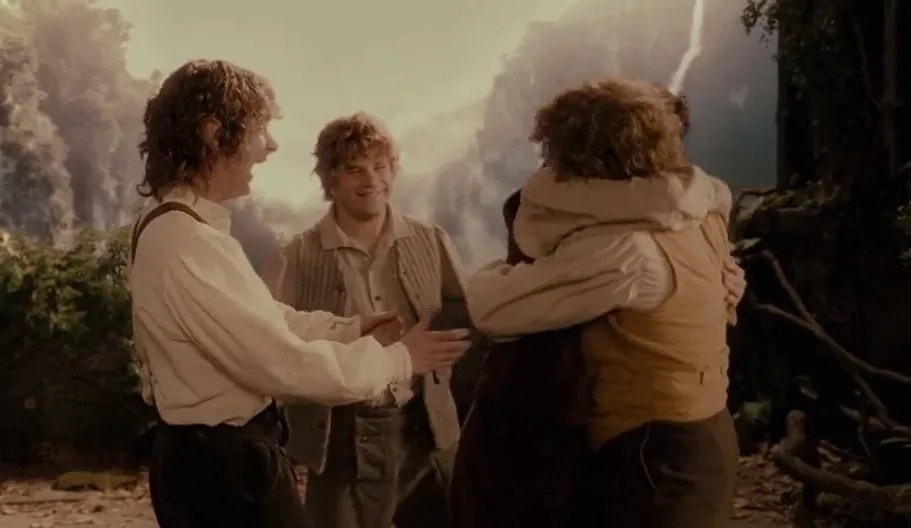 Final scene of the Lord of the Rings, the 4 hobbits that started the journey are celebrating.