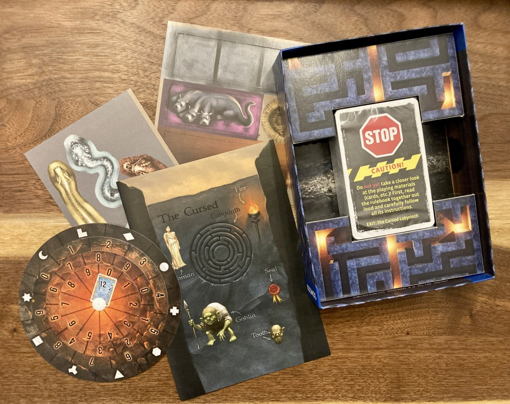 Assorted game components including a maze, a solution wheel, card deck, and instructions.