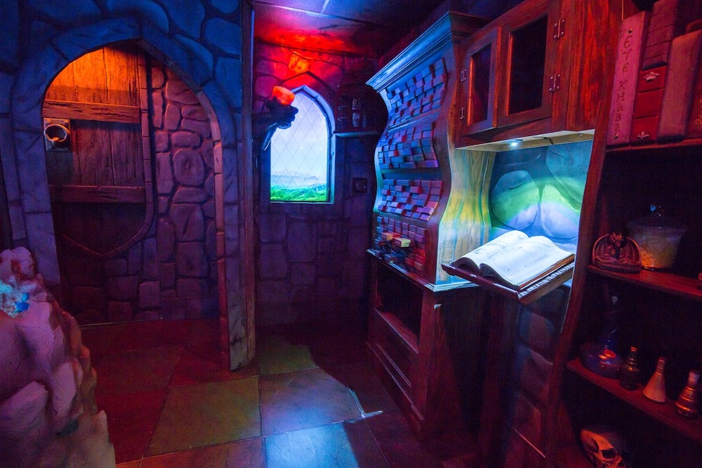 The doorway into a wizard's study, a window looks out over the countryside.