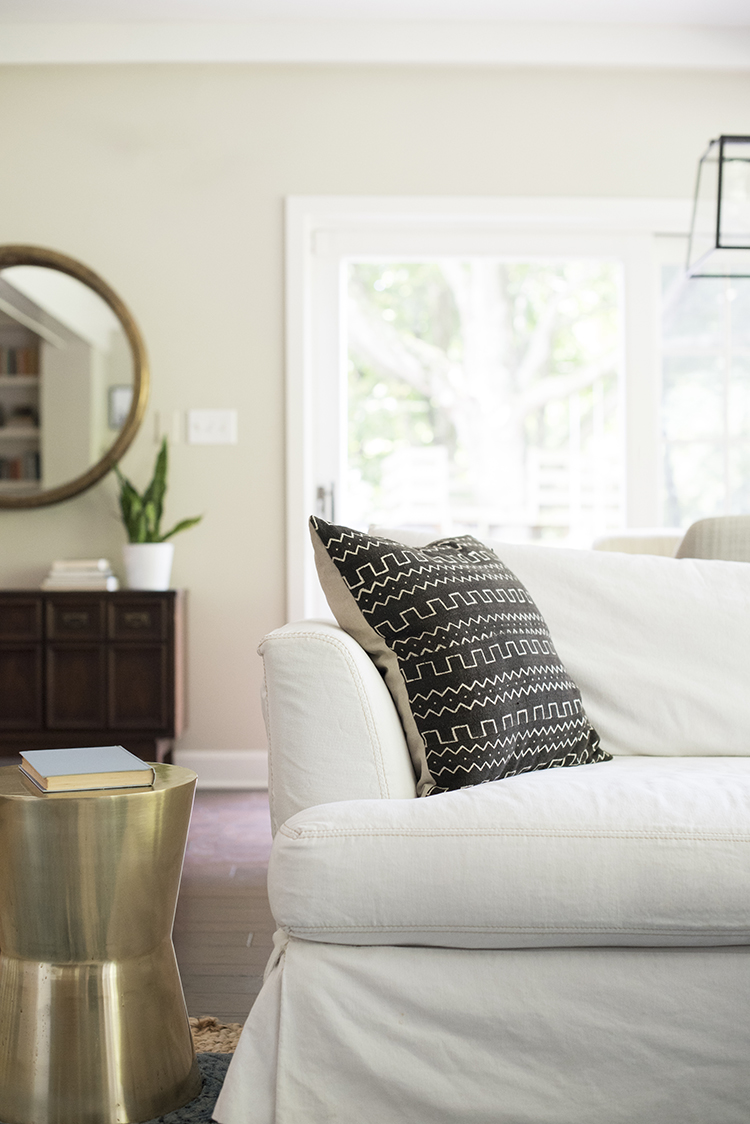 white-sofa-with-mudcloth-pillow