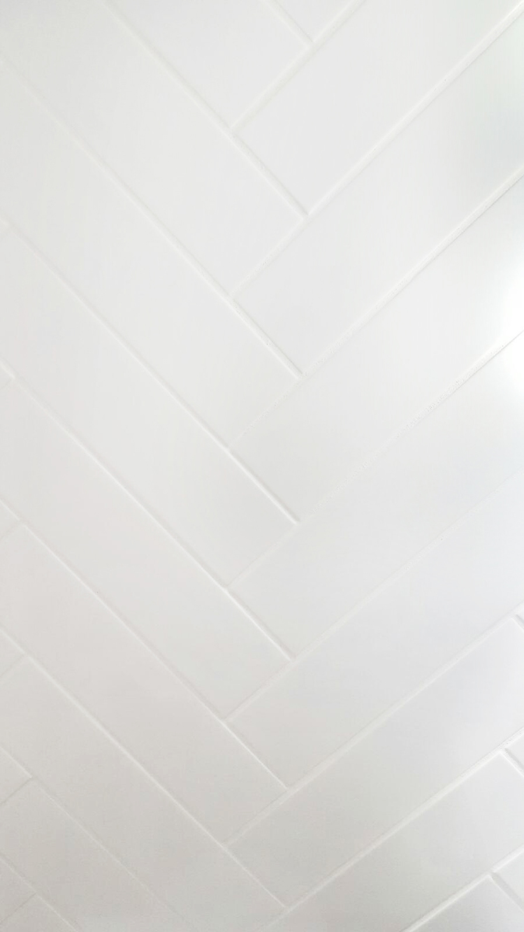 White Herringbone Tile