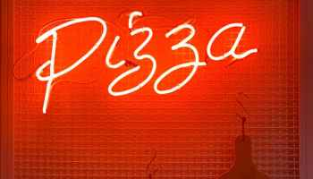pizza neon light signage beside wall