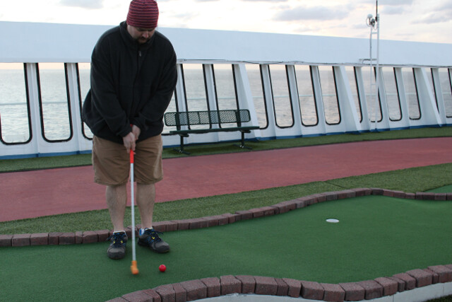 I thought we were escaping the cold winter. Playing minigolf 13 decks up from the ocean doesn't help.