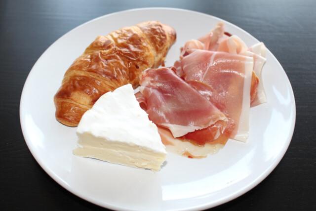 Homemade snack time sampler - croissant, camambert and prosciutto (called presunto in Portuguese)